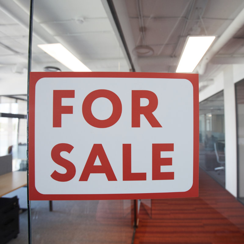 Graphic background image of red For sale sign on glass door of contemporary office space, copy space